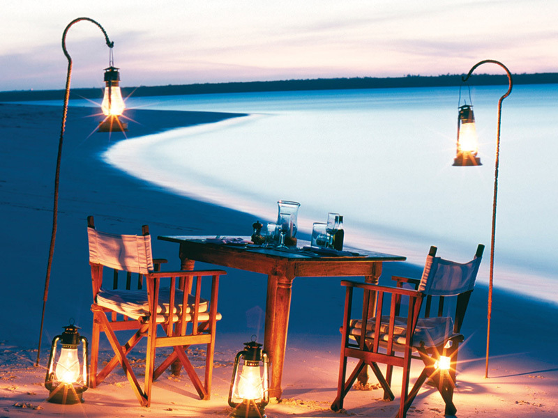 Private dinner setting at a beach