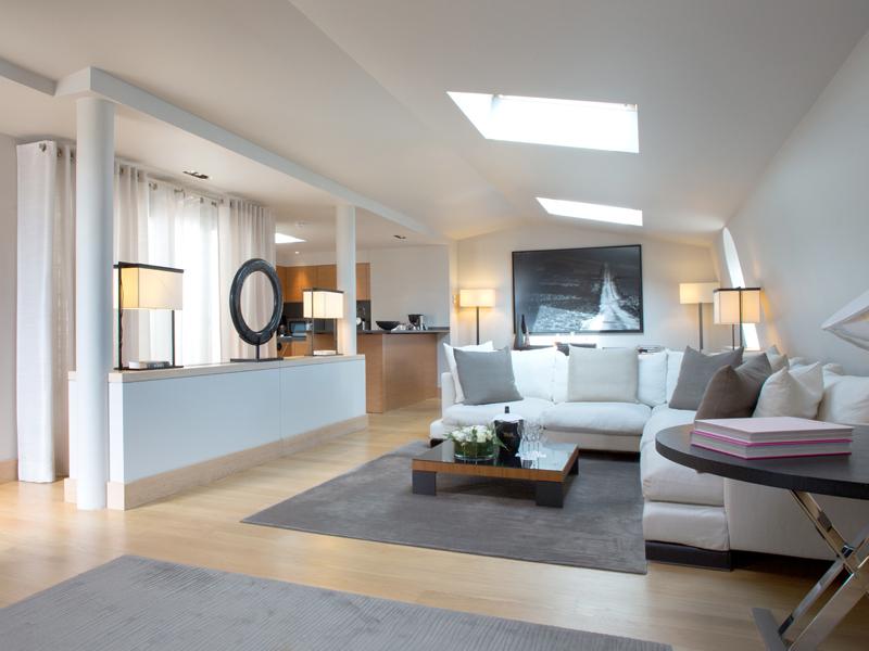 La Reserve Paris Apartments white living room